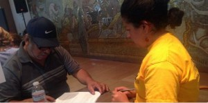Rosa, a Local 400 organizer, helps a green card holder apply for citizenship.