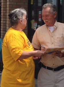 Deb, a UFCW Local 23 member talking to a customer outside her store in Ohio.