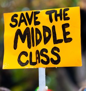 "A protest sign reading ""Save the Middle Class""."