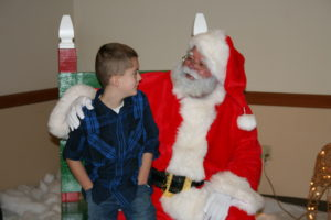 Santa (Warren Hartman) hears the Christmas wishes of a young boy at UFCW Local 653's annual Breakfast with Santa.