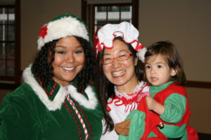 : Santa's helpers find holiday cheer with a young guest a UFCW Local 653's annual Breakfast with Santa.