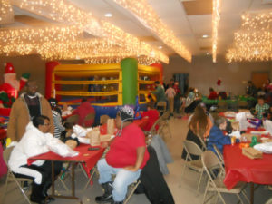Local 1189 South St. Paul Union Hall and families taking photos with Santa.